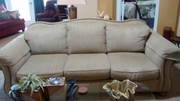 Camel back neutral sofa